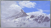 Schreckhorn with clouds clearing, painted in acrylic on canvas by Peter Young, 2008
